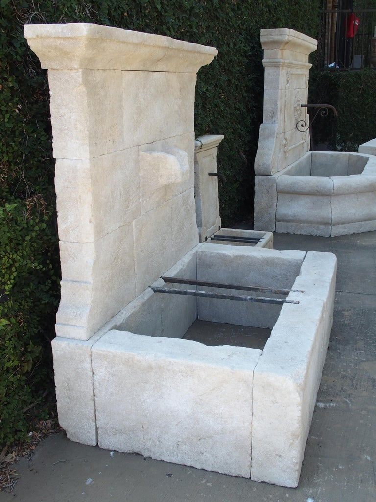This French limestone wall fountain is a good in-between size at roughly 5 feet high and 5 feet wide. The overall shape is rectilinear, and it comes with a unique carved stone spout. The design works equally well with classic or contemporary