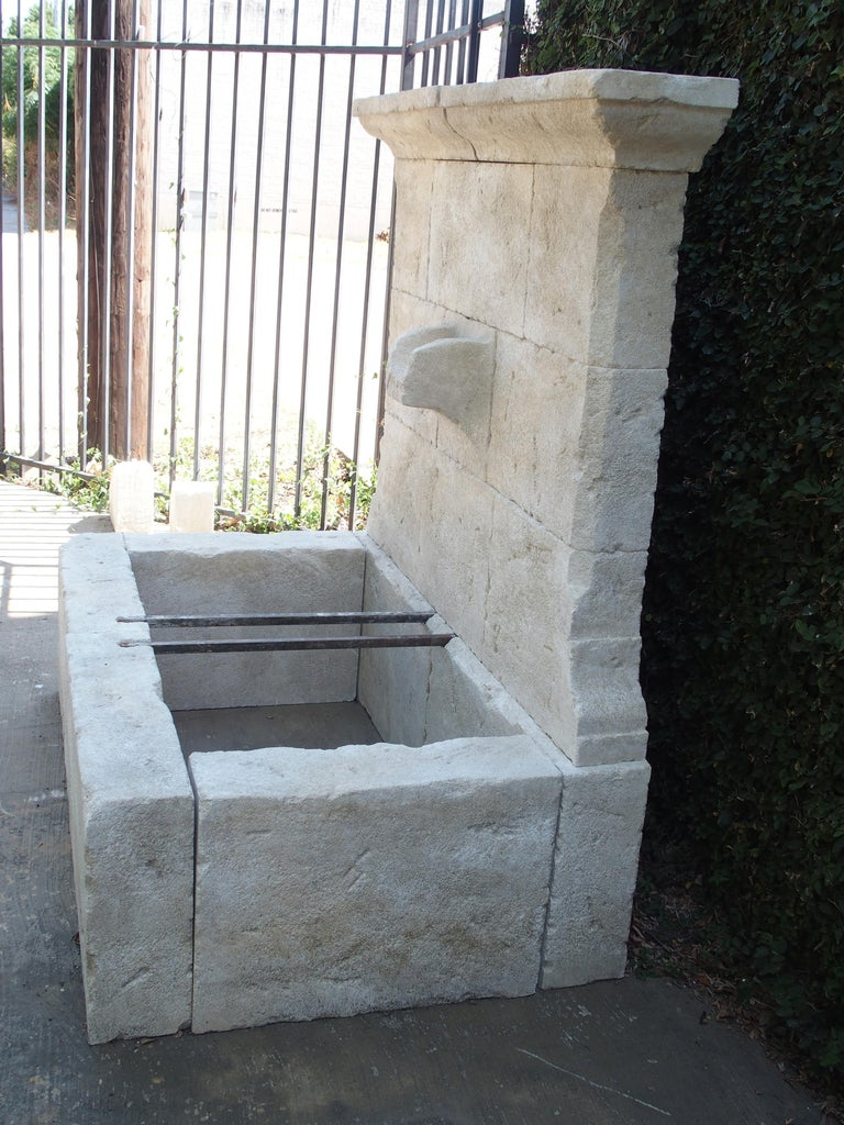 Contemporary French Limestone Wall Fountain with Carved Stone Spout For Sale