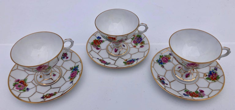 Hand-Painted Limoges Bone China Tea Cups with Legs and Saucers, Set of Three, Early 1900s For Sale