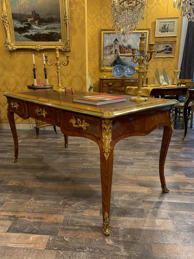 French Louis Period, flat violetwood desk with gilt bronze decoration, circa 1740-1750.
