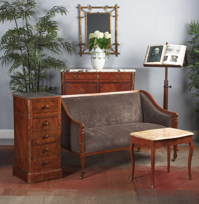 Exquisite burl walnut book veneer Louis Philippe bedside cabinet with rich gray marble top, French, circa 1850s. Beautiful burl walnut clad oak with book veneer front and a seated dark gray marble top. Square in form with canted corners and a
