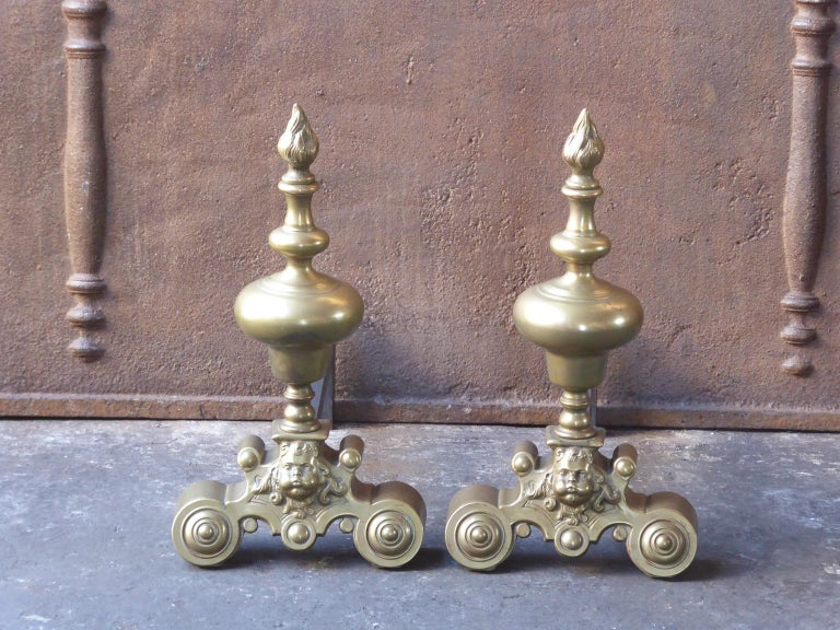 20th century French Louis XIV style andirons made of brass and wrought iron.