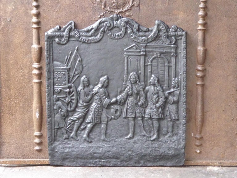 20th century French Louis XIV style fireback with the inscription: ''L'adieu du roy d'Espagne avec le roy de France''. Louis XIV says farewell to his grandson Philippe V, who has been freshly elected king of Spain with the words: 'My son, there are