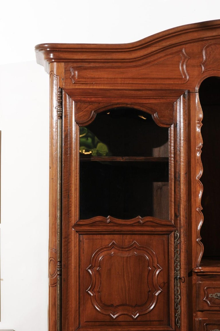 Hand-Carved French Louis XV 18th Century Walnut Provençal Bookcase with Doors and Drawers For Sale