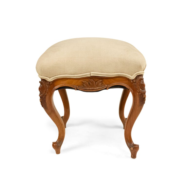 French Louis XV style (19th century) walnut square bench with beige upholstered seat.