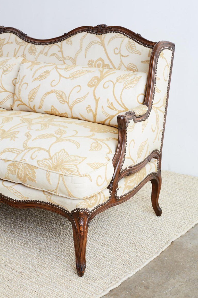 French Louis XV Carved Wingback Crewel Sofa at 1stdibs