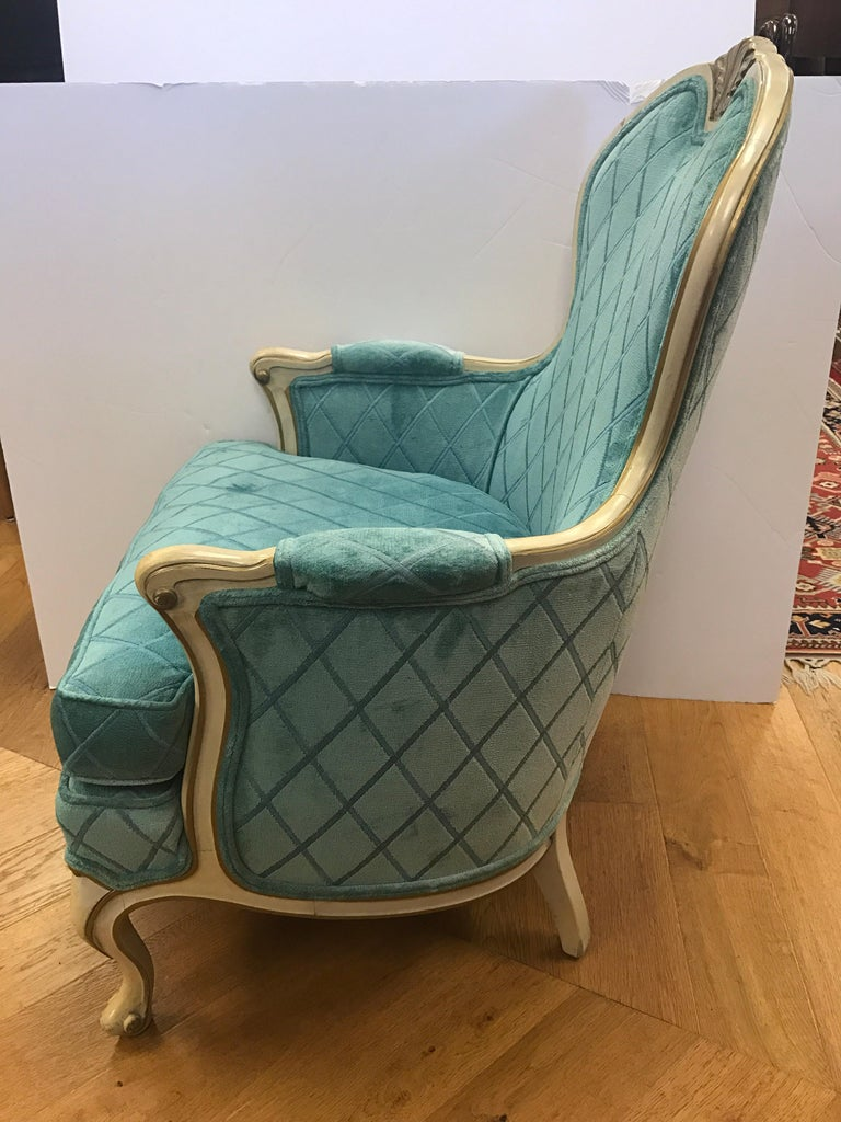 Stunning Louis XV bergère armchair with a wonderful turquoise fabric. All dimensions are below and seat height is 18 inches.