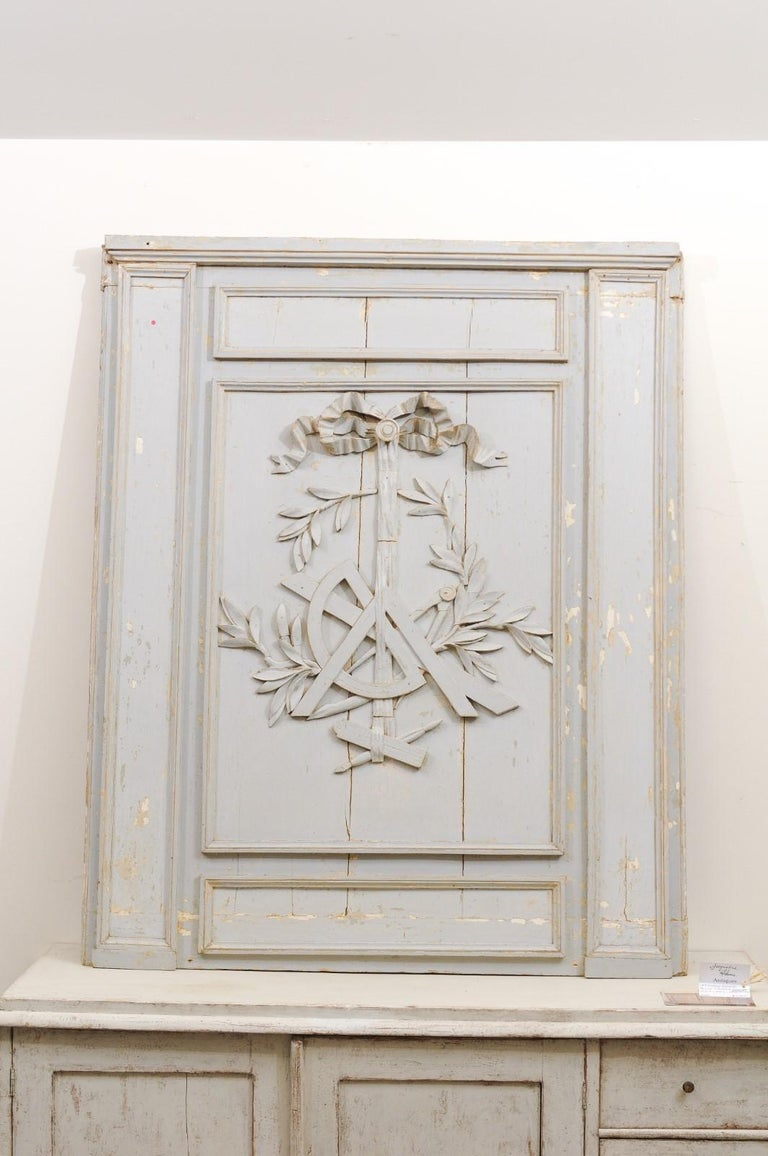 A French Louis XV period mid-18th century architectural panel from Burgundy scraped to its original paint, with ribbon-tied science trophy. Born in Burgundy during the later years of the reign of king Louis XV, this French architectural panel