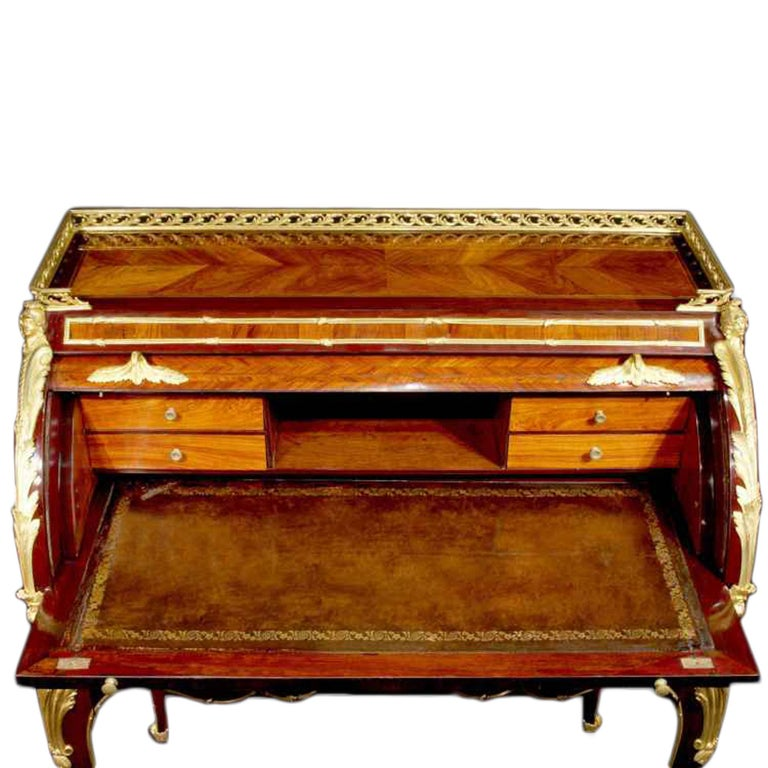A sensational quality and extremely elegant 18th century, circa. 1750, French Louis XV period Bureau à Cylindre. The bureau is raised by four cabriole legs decorated by ormolu chutes and sabots. The chutes continue to the scalloped apron with three