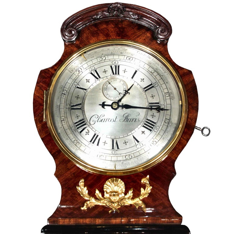 A sensational French Louis XV period, circa 1740, tall case clock with an extremely rare mechanism movement signed Jean Charost. The original case in kingwood, ebony and rosewood veneer is highly decorated by impressive ormolu mounts with a female
