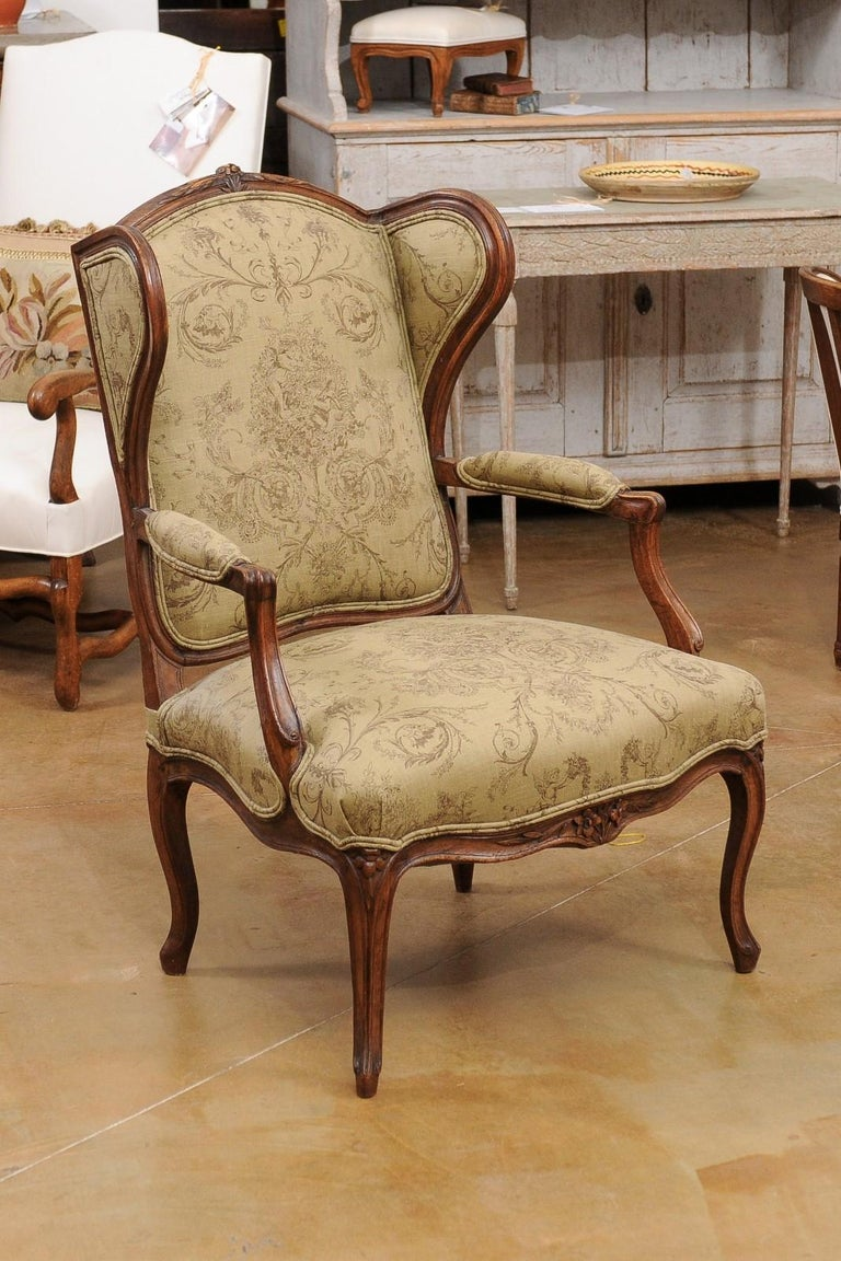 French Louis XV Style 1890s Wingback Chair with Upholstery and Carved Motifs In Good Condition For Sale In Atlanta, GA