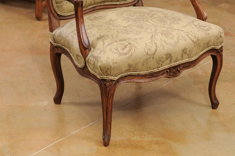 19th Century French Louis XV Style 1890s Wingback Chair with Upholstery and Carved Motifs For Sale