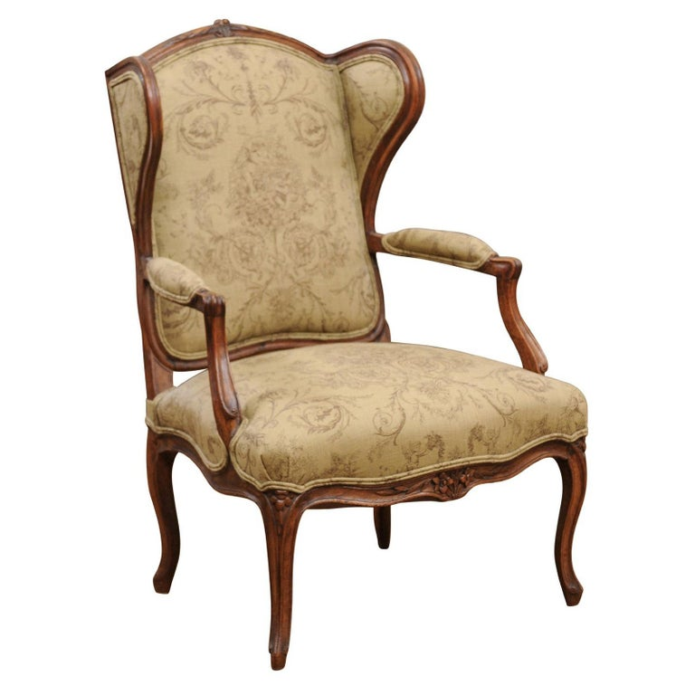 French Louis XV Style 1890s Wingback Chair with Upholstery and Carved Motifs For Sale