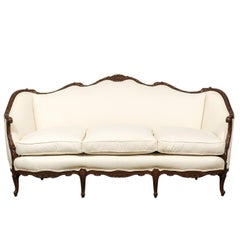 French Louis XV Style 19th Century Hand-Carved Walnut Canapé with New Upholstery