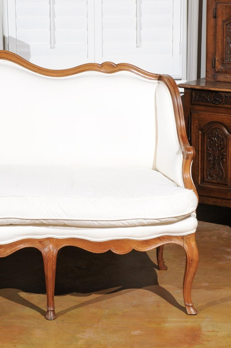 Upholstery French Louis XV Style 19th Century Walnut Wingback Canapé with Cabriole Legs For Sale