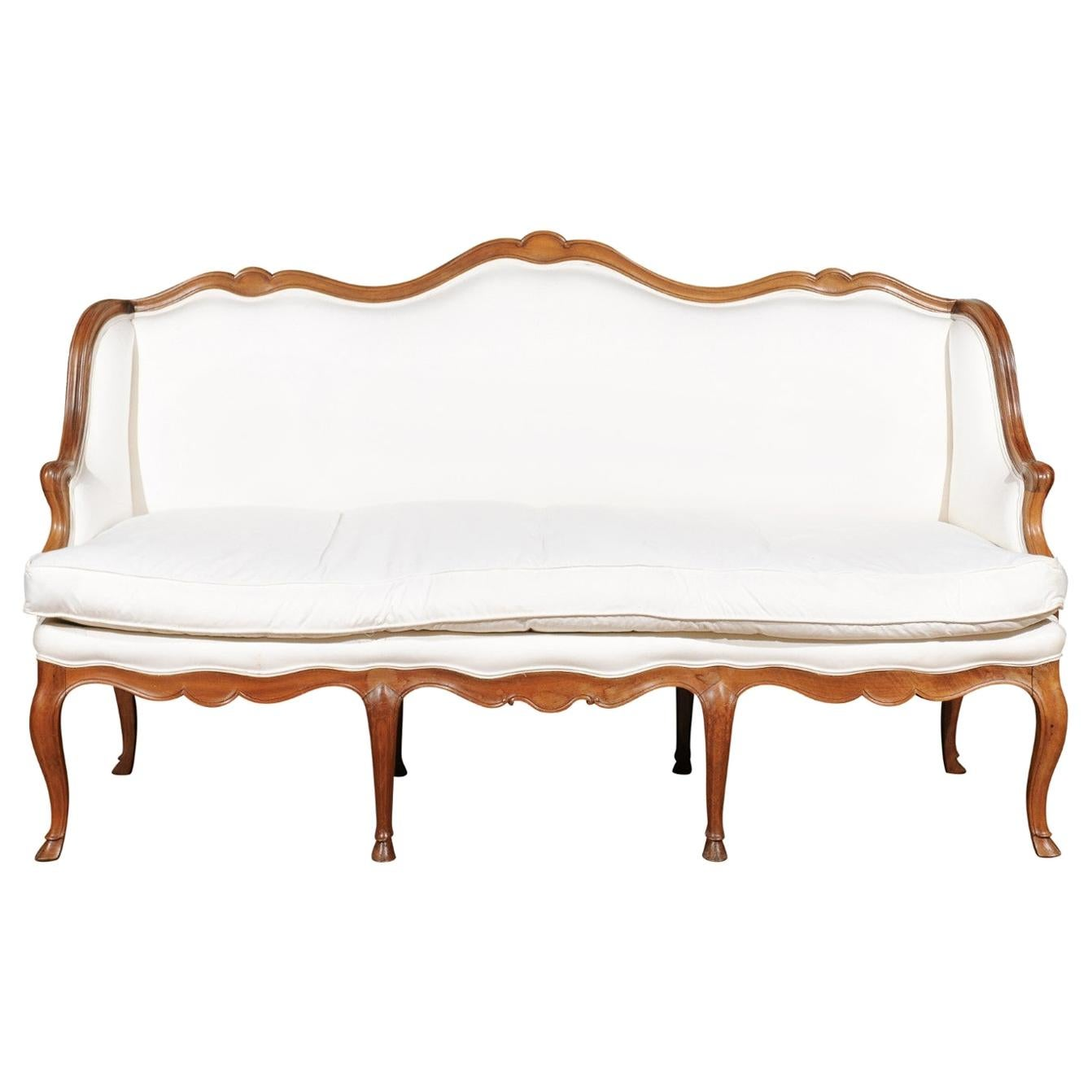 French Louis XV Style 19th Century Walnut Wingback Canapé with Cabriole Legs