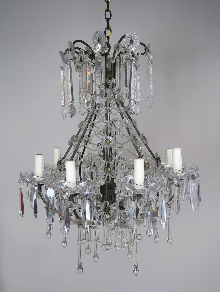 French Louis XV style 8-light beaded crystal chandelier. The fixture is adorned with unique hand cut crystal spheres and drops throughout. An intricate lattice work design is made with tiny beads and separated with handmade beaded flower accents.