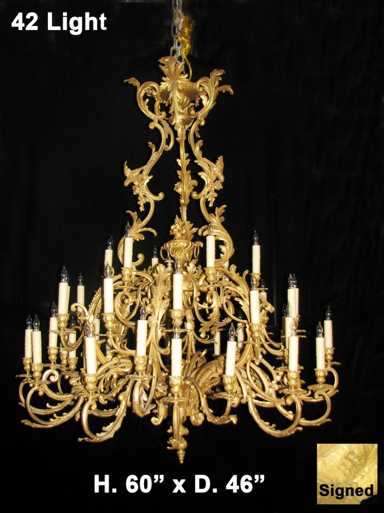 Sensational 19th century French Louis XV style doré bronze two-tier 42-light chandelier with birds.  Signed BR.  The exquisite doré bronze chandelier is surmounted in an ormolu acanthus crown, conjoined with double-scroll and foliate motif