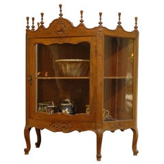 French Louis XV Style Walnut Display Cabinet with Glass Door and Carved Motifs
