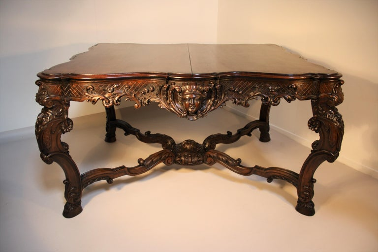 A very fine French Louis XV hand carved walnut centre table or dining table in Rococo style from the 19th century.