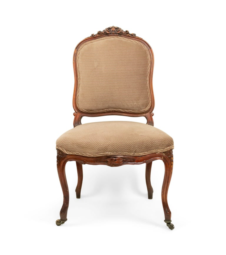 Pair of 19th century French Louis XV style walnut side chairs with a carved back crest and brown upholstered seat and back (1 leg as is).