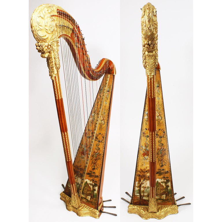 A very fine French Louis XVI period carved, gilt and hand painted wooden Harp by Jean-Henri Naderman (Swiss, 1735-1799). The ornately carved body with acanthus leaves and painted with flowers, ribbons, musical trophies and pastoral scenes as well as