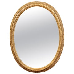 French Louis XVI Oval Giltwood Mirror, Late 18th Century