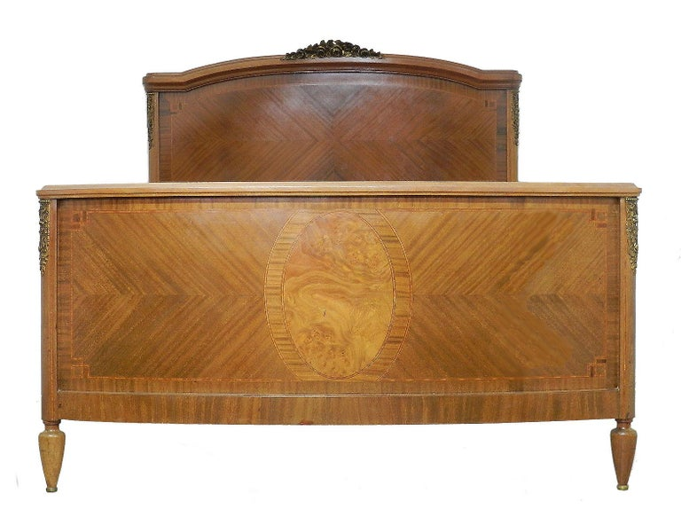 French antique bed Louis XVI revival, circa 1920 Marquetry and Ormolu gilt bronze Very handsome This bed will take a standard US Queen or UK king size mattress on either wooden slats or box base (not included) across the whole width of the