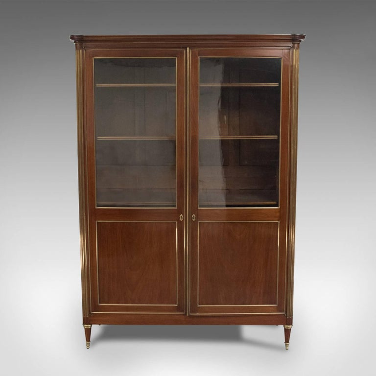 This is a 19th century, French, Louis XVI revival, two-door bookcase, vitrine or cabinet dating to circa 1880.