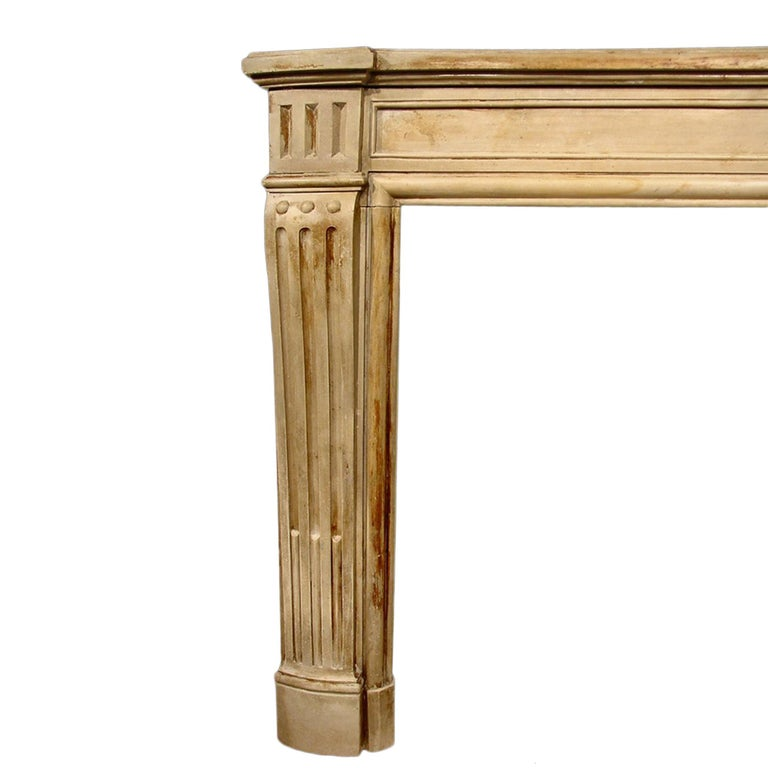 A wonderful and charming French 19th century Louis XVI style small scale stone mantel with fluted jambs and a moulded shelf. Interior dimensions: H 32