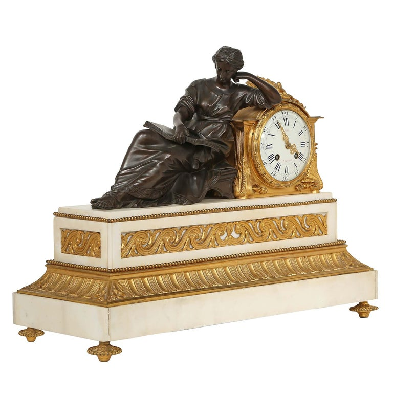 A handsome French mid 19th century Louis XVI st. mantel clock, signed Jean, A Rennes. The clock is raised by ormolu topie shaped feet below a rectangular white Carrara marble base with finely chased reeded bands an ormolu running wave design,
