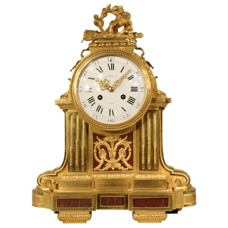 French Louis XVI Style Mid-19th Century Ormolu Marble Clock, Signed Frères For Sale