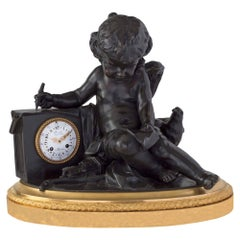 French Louis XVI St. Ormolu and Patinated Bronze Clock, Signed by Deniere