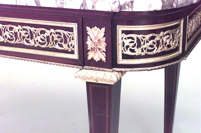 French Louis XVI style (19th century) mahogany and inlaid single drawer center table with bronze trimmed apron and white marble top.