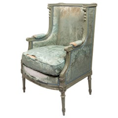 French Louis XVI Style Bergère Armchair with Distressed Fabric