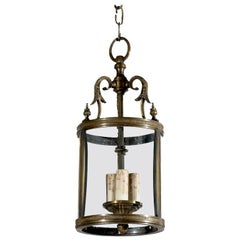 French Louis XVI Style Bronze Three-Light Lantern with Glass Panels and Finials
