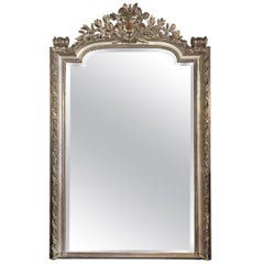 French Louis XVI Style Carved and Silver Leaf Mirror