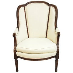 French Louis XVI Style Carved Beechwood Bergère Chair in Cream Colored Linen