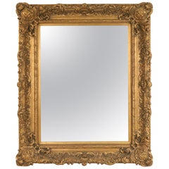 French Louis XVI Style Carved Giltwood Fleur-de-Lis Design Wall Mirror