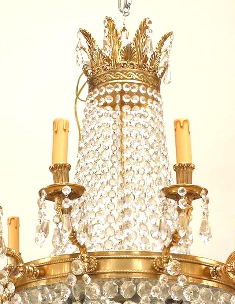 French Louis XVI style (modern) chandelier with 12 arms supported by a bronze ring with multiple beaded crystal strands converging on a bottom finial and extending to top.