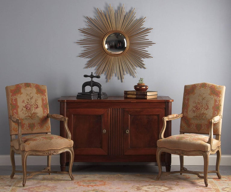A handsome antique Louis XVI style cherrywood buffet, French, circa 1800. Richly toned cherrywood case piece with ample storage, it is all cabinet space with no drawers, what the French call