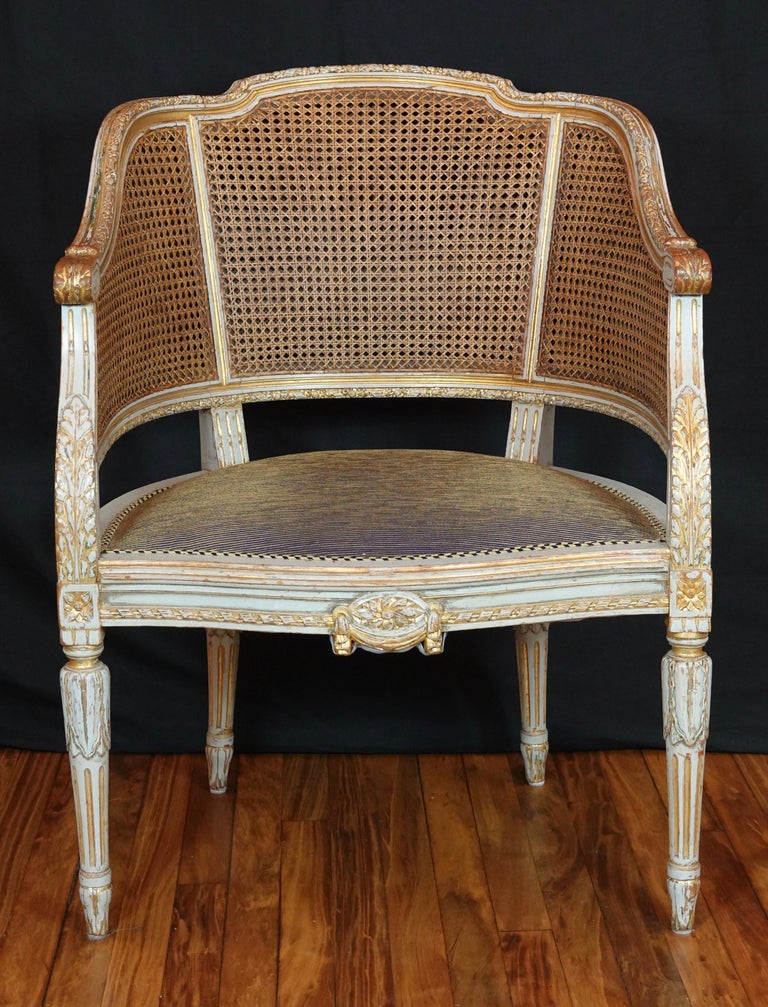 An elegant French caned desk chair or