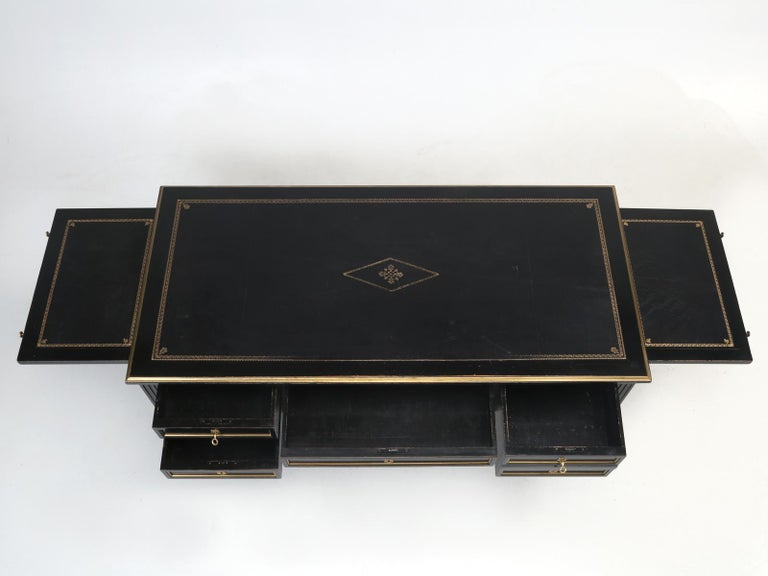 French Louis XVI style desk, in it's original black lacquer finish, with a matching black leather top, that was tastefully adorned with gold trim. Difficult to determine, if this black lacquer French Louis XVI desk was made before the great war or