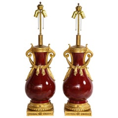 French Louis XVI Style Dore Bronze & Chinese Sang De Boeuf Porcelain Lamps, Pair