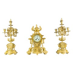 French Louis XVI Style Gilt Bronze Three-Piece Garniture Clock Set