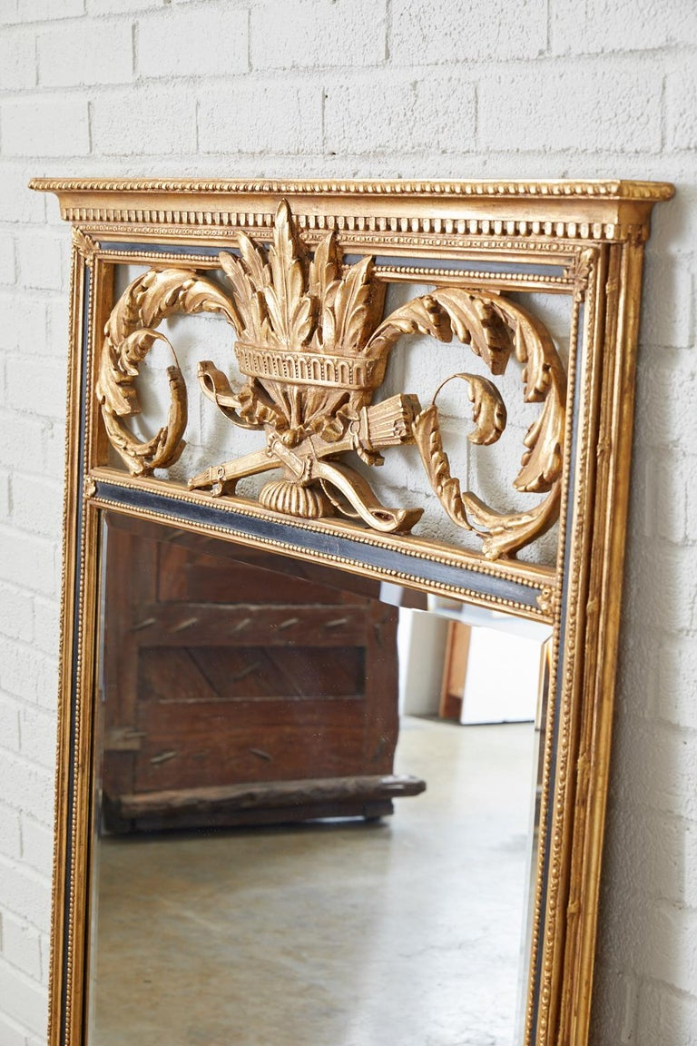 Beveled French Louis XVI Style Giltwood Mirror by Friedman Brothers For Sale