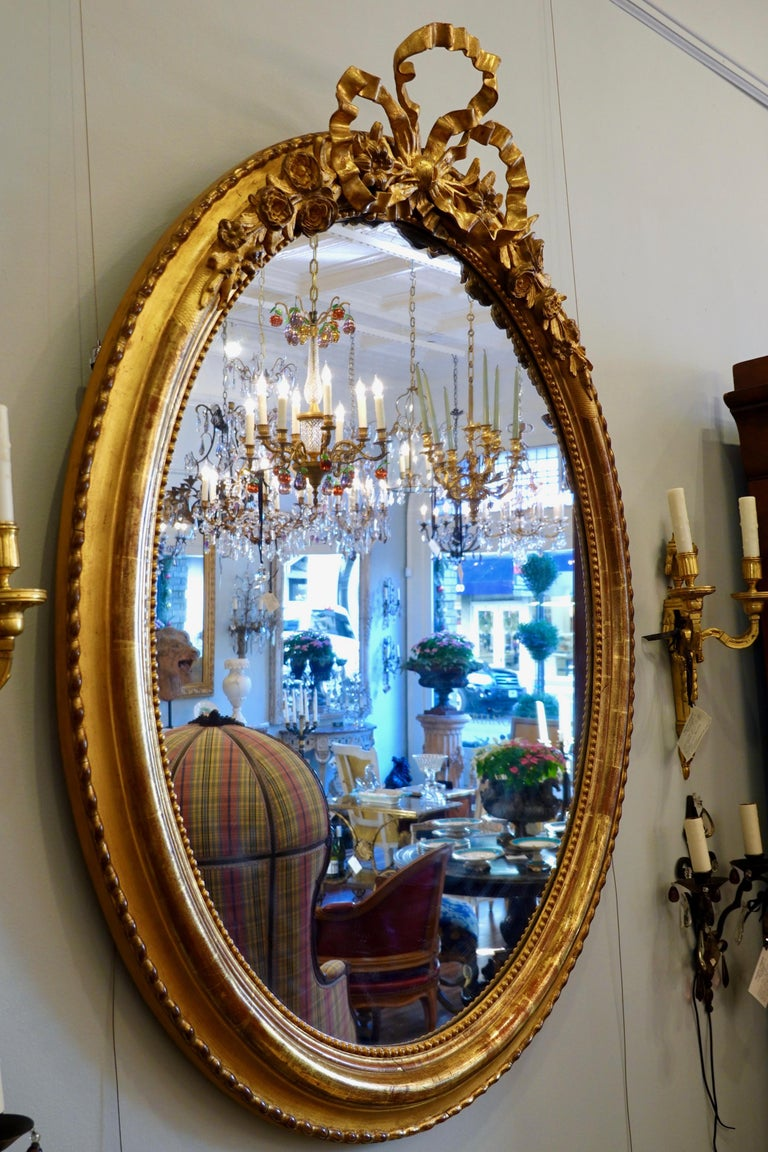 Hand-Carved French Louis XVI Style Giltwood Mirror with Large Carved Bow Cartouche For Sale