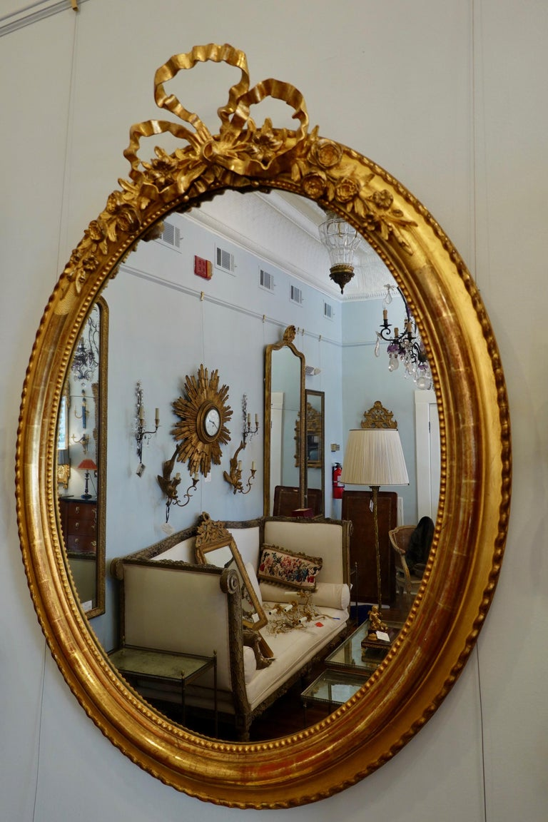 French Louis XVI Style Giltwood Mirror with Large Carved Bow Cartouche In Good Condition For Sale In Charleston, SC