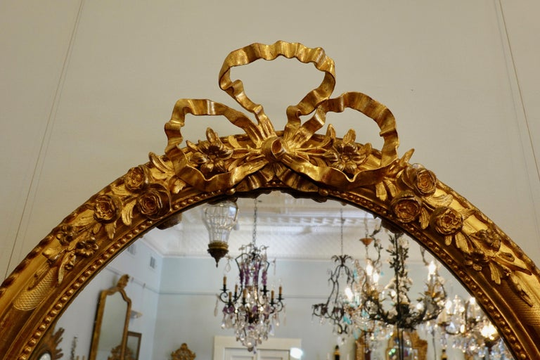 19th Century French Louis XVI Style Giltwood Mirror with Large Carved Bow Cartouche For Sale