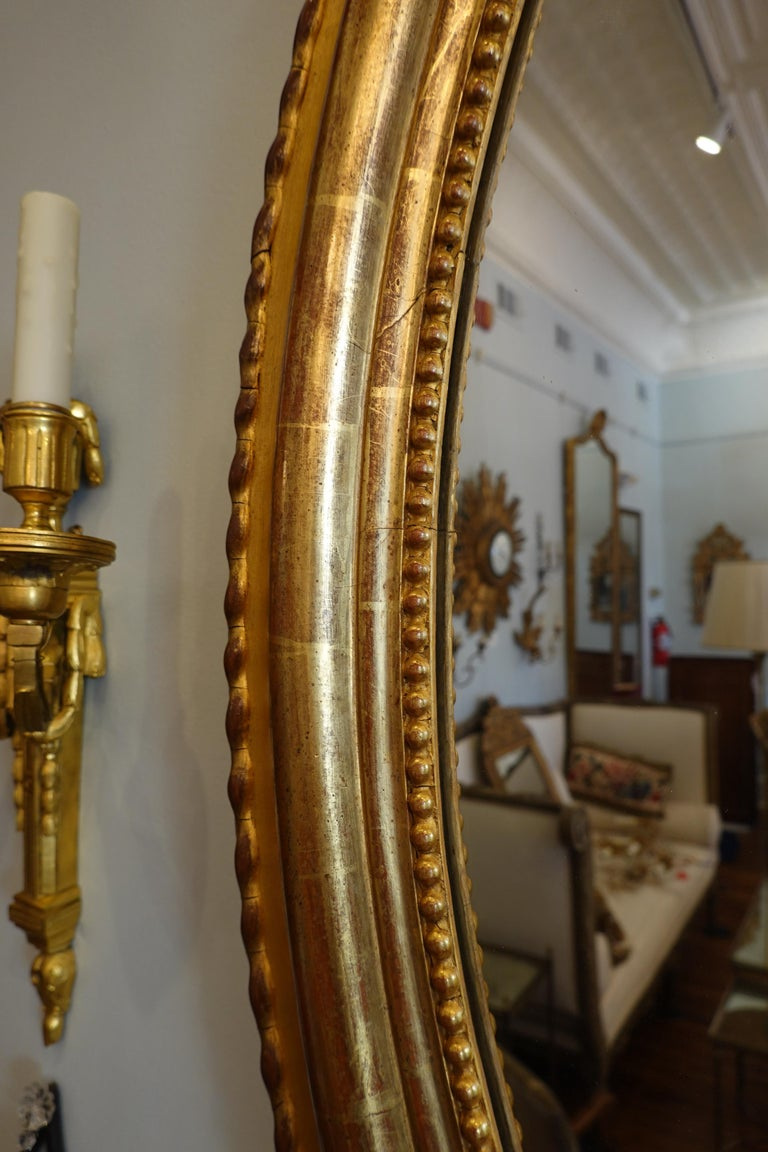 French Louis XVI Style Giltwood Mirror with Large Carved Bow Cartouche For Sale 2